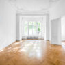 room in old apartment building with wooden parquet floor - real estate interior